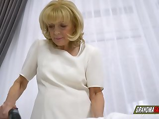 sweet grandmother takes care of her grandson