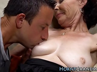 Mature woman sucks dick
