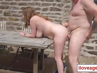 Lily May'_s matured twat slammed by her partner from behind outdoor