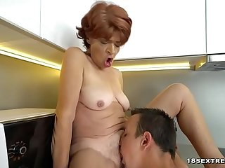Guy fucking a hairy granny snatch in the kitchen
