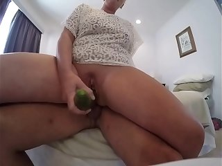 Churning creampied pussy with cucumber