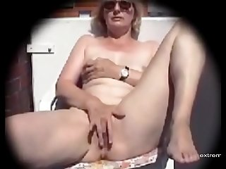 My mom masturbates on our balcony