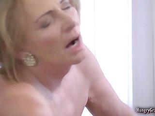 Horny blonde grandma enjoying a hard cock
