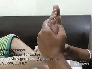 Kaamdeva Massager massaging his Clients legs and available for Ladies only at playboy.gorakhpur@gmail.com