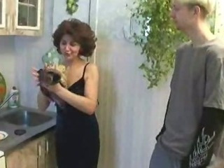 Russian mom and son playing in kitchen