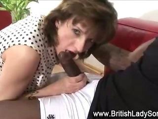 Horny mature Lady Sonia sucks on cock