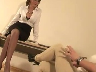 Mature stocking slut femdom gives footjob