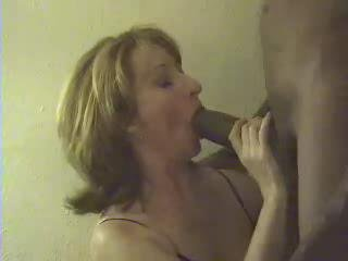 Mature's mouth full of chocolate sausage