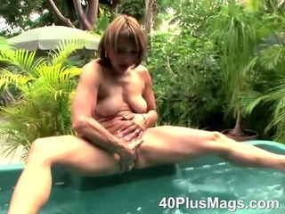 Mature slut Ann taking a bath